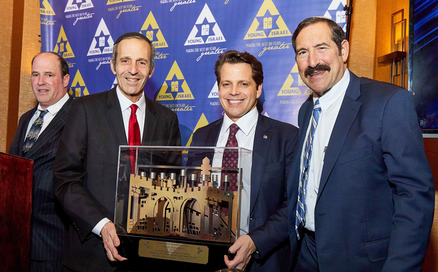 At NCYI's 2018 gala, Anthony Scaramucci, former press secretary for President Trump, was presented with the Friend of Zion Award by (from left) NCYI President Farley Weiss, Journal and Dinner Coordinator Judah Rhine, and NCYI First Vice President Dr. Joseph Frager.