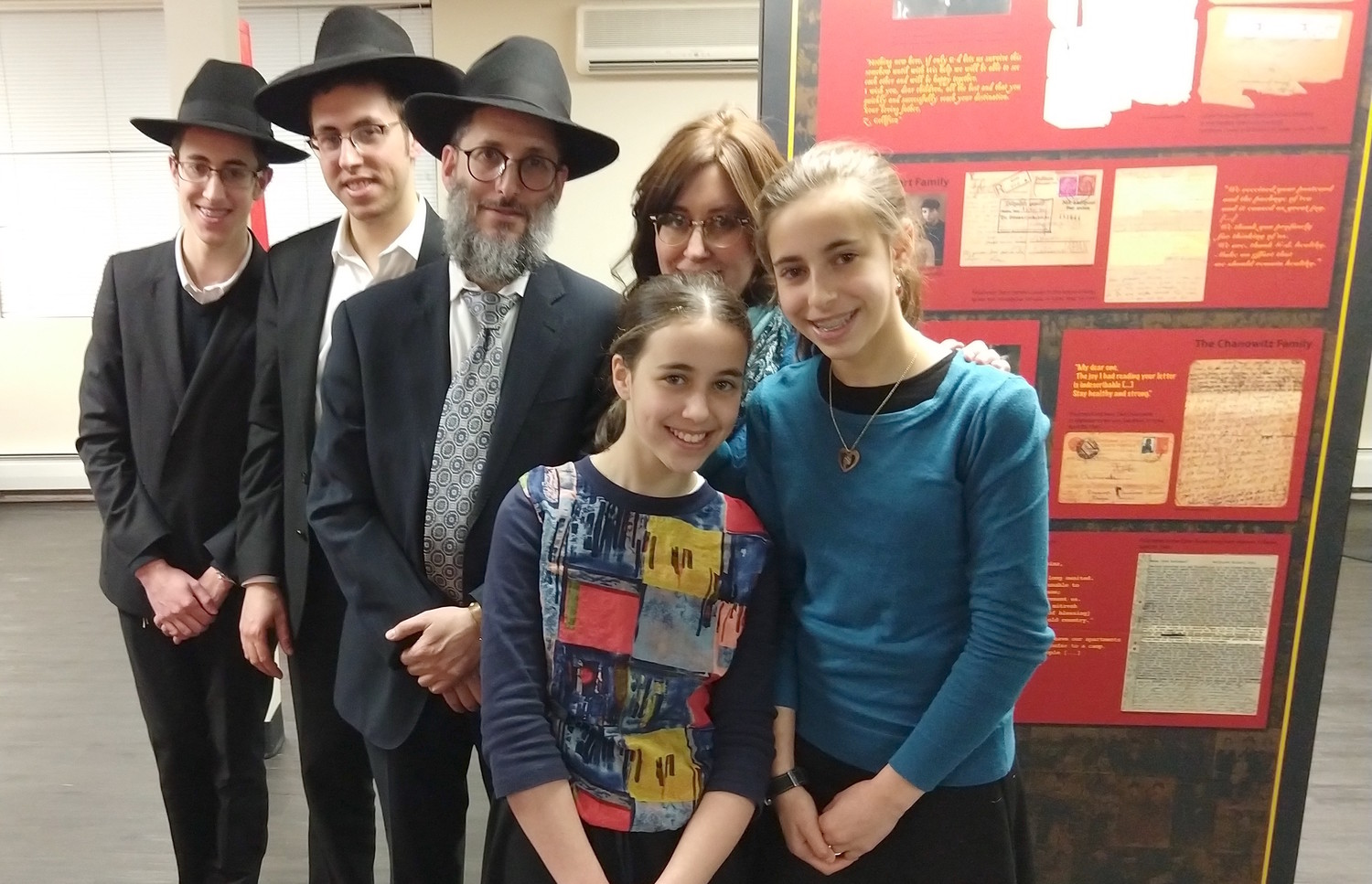 Yehuda and Breindy Gelbfish, at the Brooklyn museum with four of their 10 children, loaned a number of items that belonged to Yehuda's father Benjamin, a Lublin Yeshiva student who fled to Vilna.