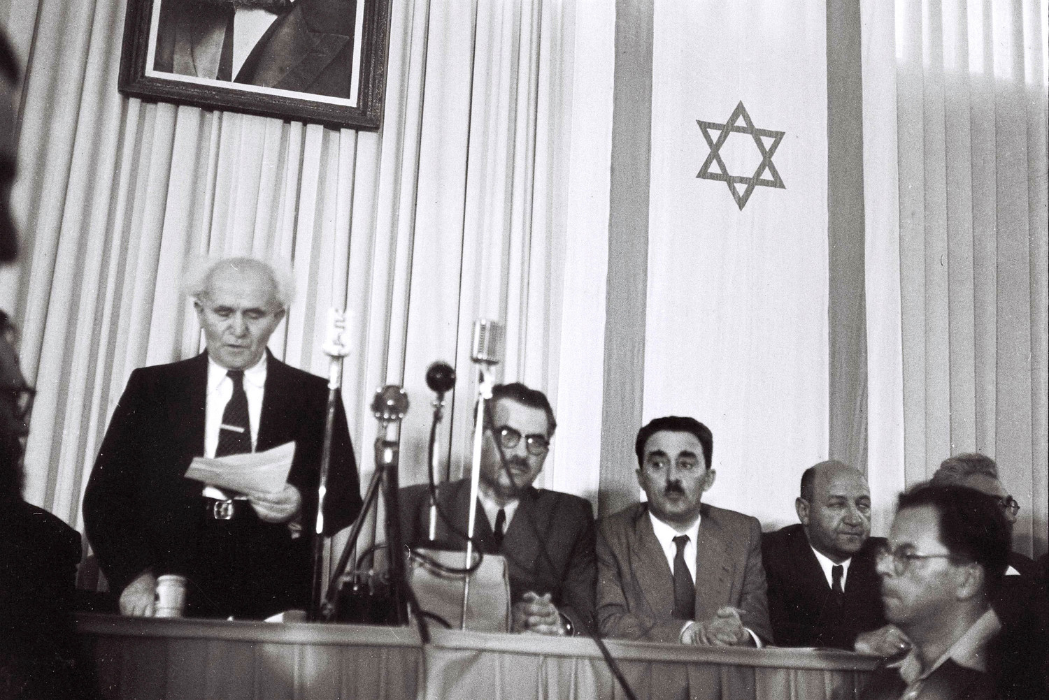 David Ben Gurion, who was to become Israel's first Prime Minister, reads the Declaration of Independence May 14, 1948 at the museum in Tel Aviv, during the ceremony founding the State of Israel.