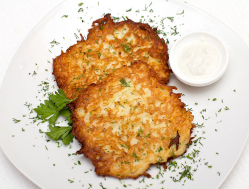 Fried potato pancake with sauce on a plate