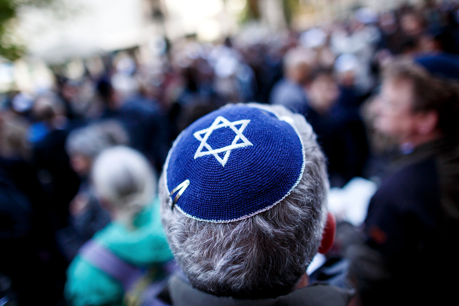 A man wearing a kippah at an April 25 gathering in Berlin to protest anti-Semitism.