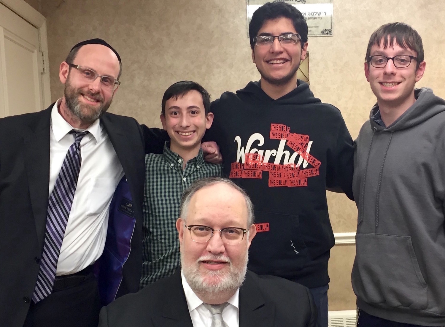 From left: Rabbi Shimon Chrein, Adam Speiser, Jonah Rocheeld, and Moshe Wieder. In front: Rabbi Mair Wolofsky, coordinator and founder of the Metropolitan Torah Bowl League in 1995.