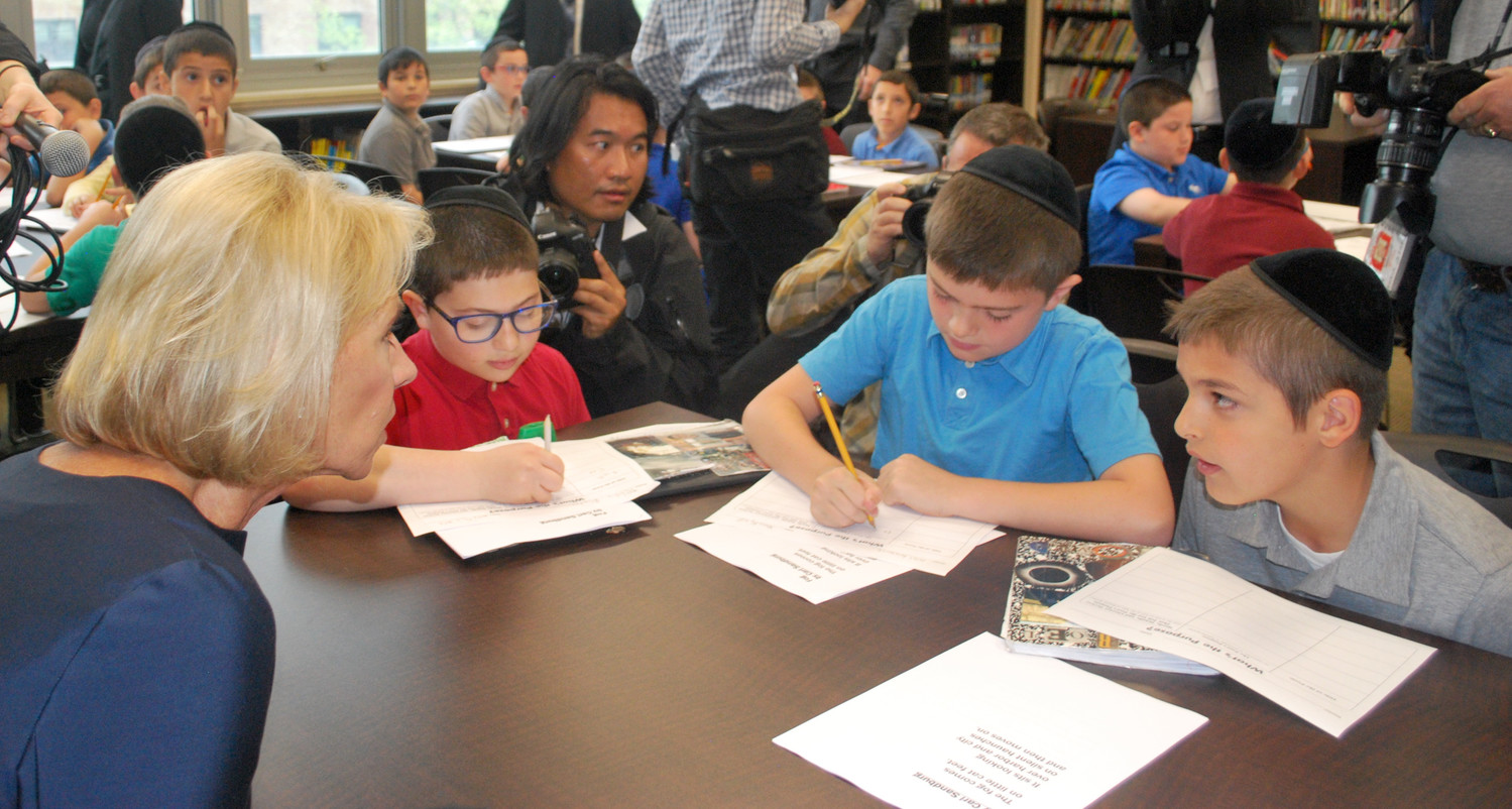 Students at Yeshiva Darchei Torah students explain to Secretary of Education Betsy DeVos what they're learning about poetry.