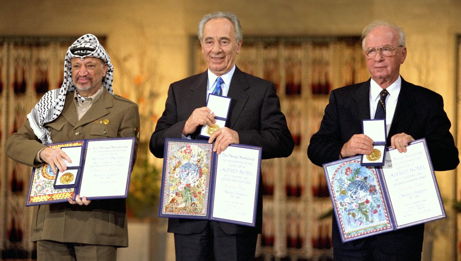 In 1994 (from left) Yasser Arafat, Shimon Peres and Yitzhak Rabin won the Nobel Peace Prize for their roles in the Oslo Accords. A permanent peace did not follow.
