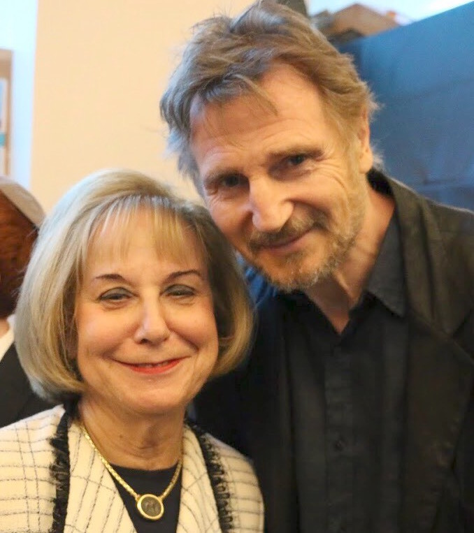 "Associate Principal Judith Melzer with actor Liam Neeson, who played Oskar Schindler in the Oscar-winning film, ""Schindler's List."""