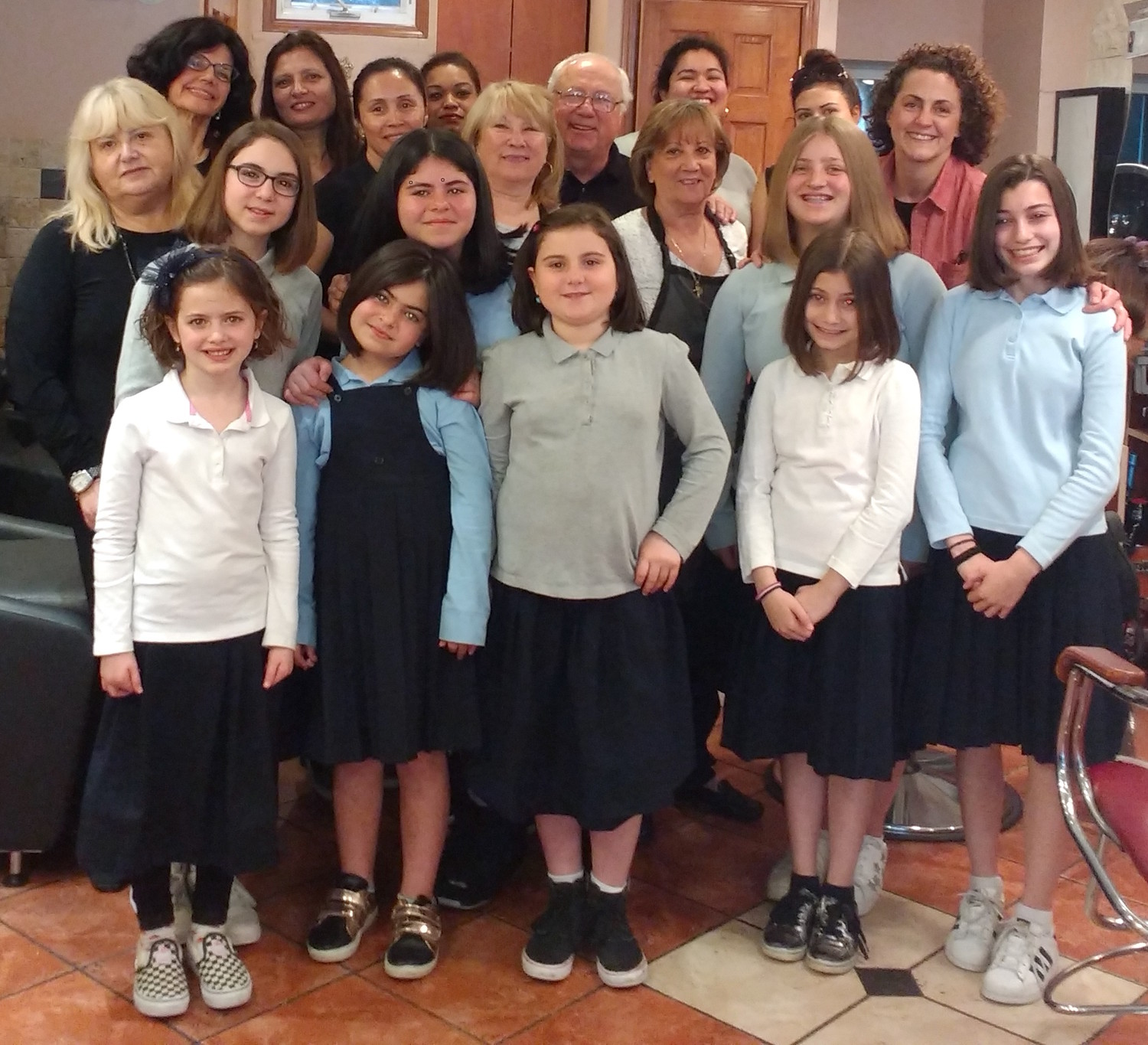 The Shulamith girls after the cut: The eight girls are: second graders Kira Gurevich and Shani Edery, third grader Shira Levine, fifth grader Ahuva Moskowitz, and seventh graders Rachel Levine, Michal Moskowitz, Noy Edery and Talia Bennett.