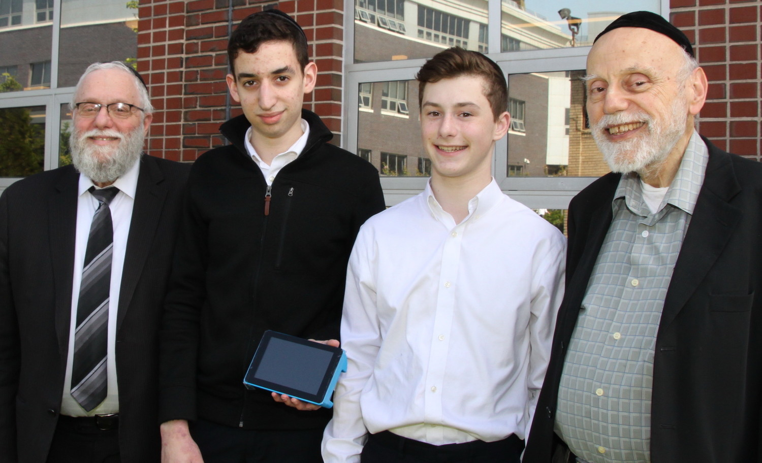 Darchei Torah's Dan Yaakov Honig and Yisroel Rosenberg, two Mesivta Chaim Shlomo students who won a prize at the CIJE competition, are flanked by Rabbi Menachem Gold, principal (left), and Dr. Don Engelberg, physics instructor.