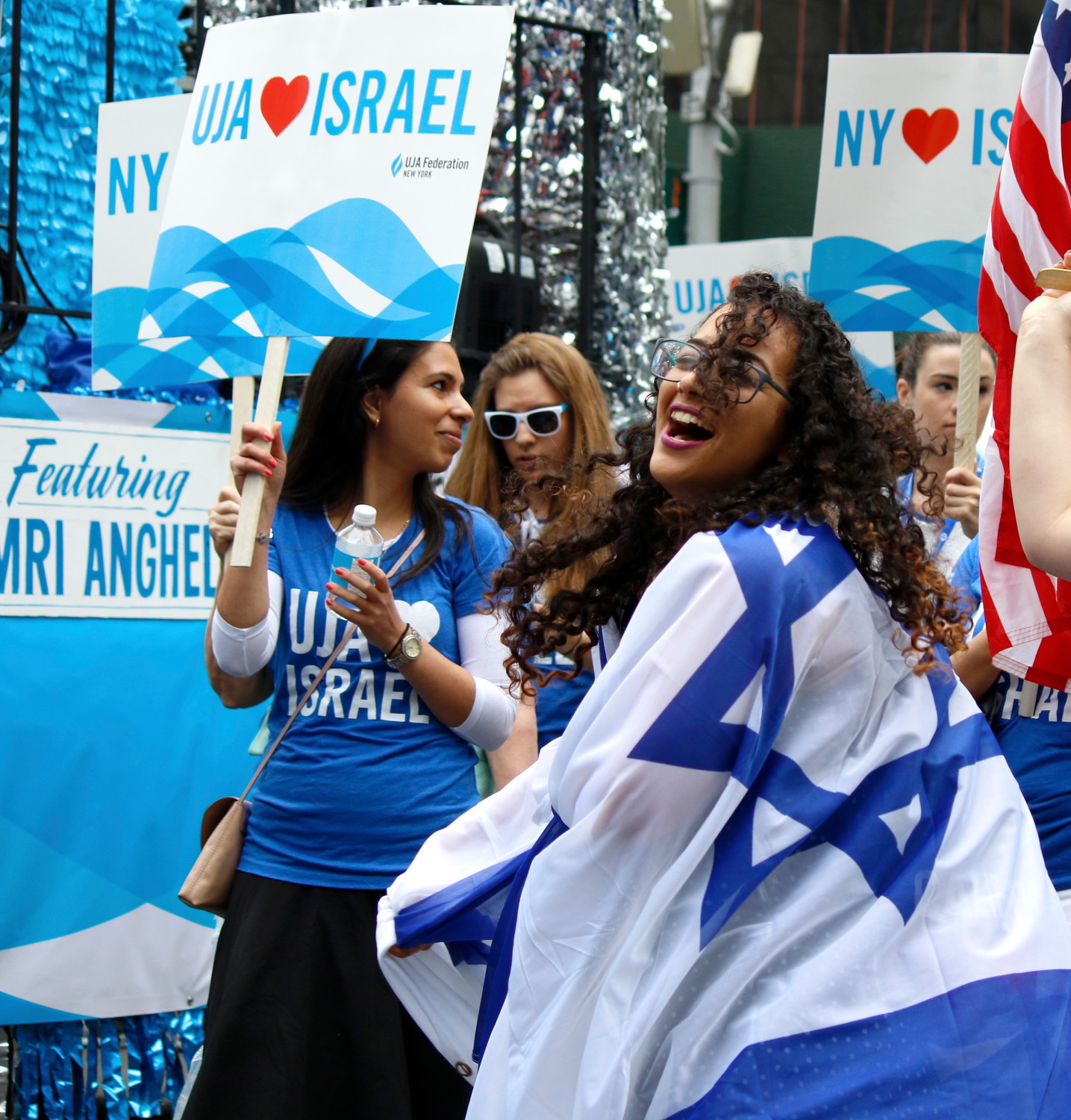 Flags fly as NY celebrates Israel: Marcher from UJA Federation New York shows her blue-and-white.