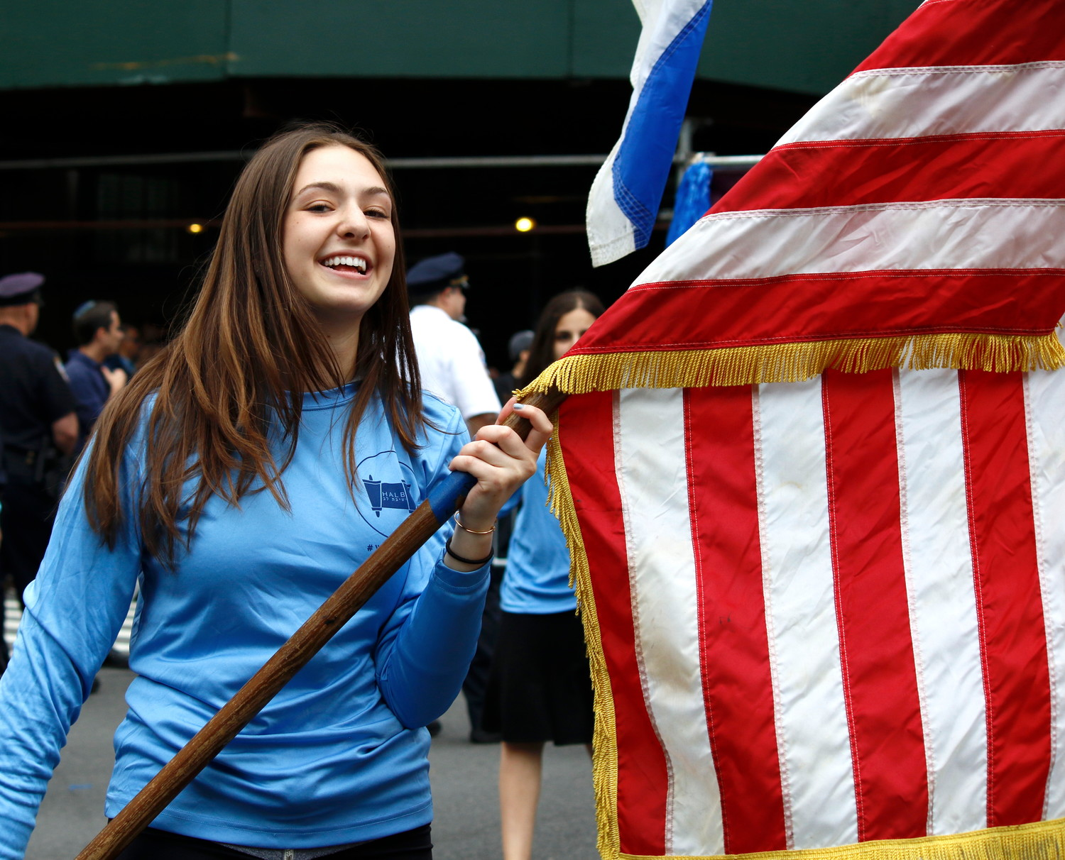 An SKA student carried the red-white-and-blue at the Celebrate Israel Parade.