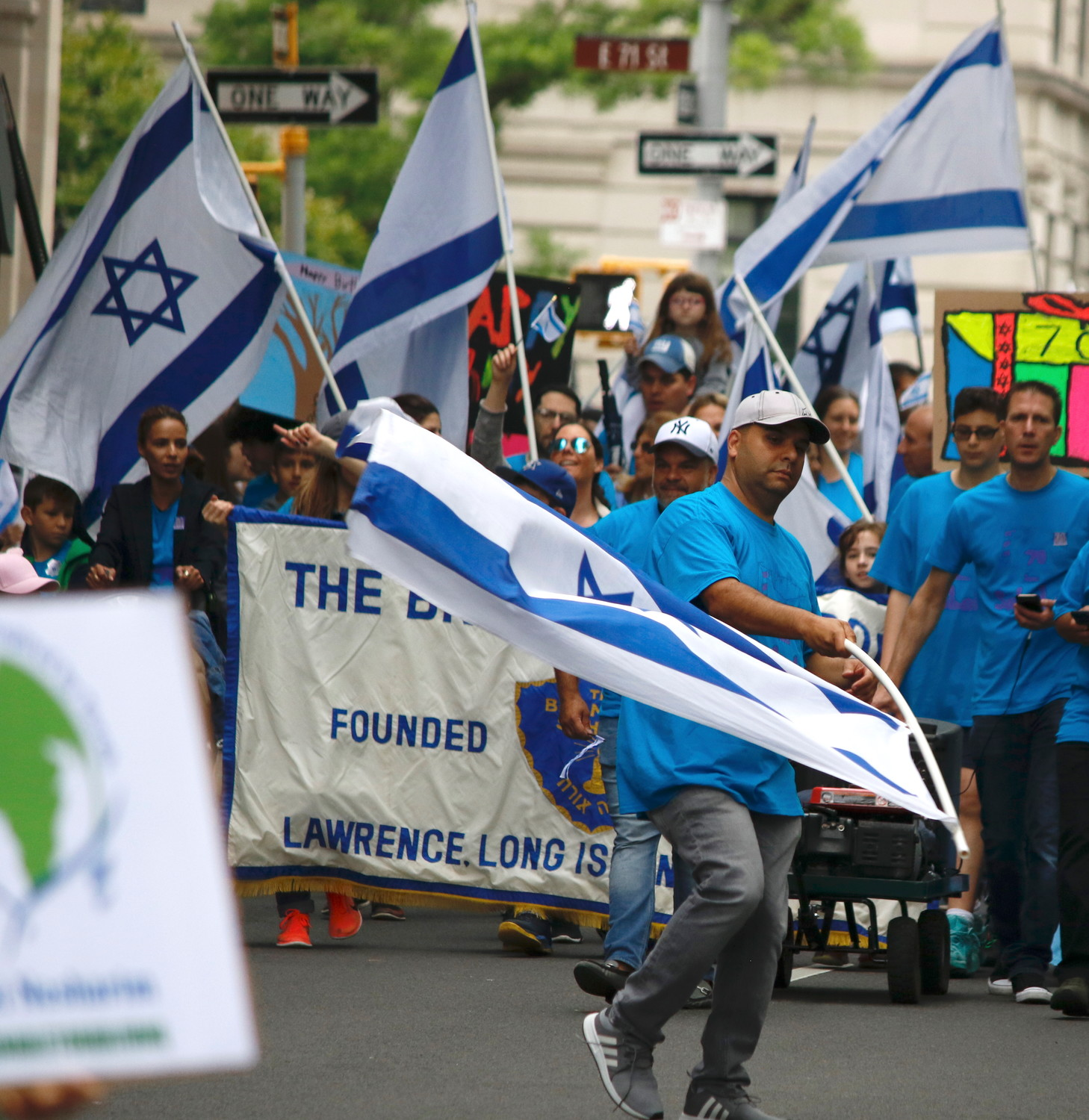 A member of the contingent from the Brandeis School in Lawrence waves Israel's flag.
