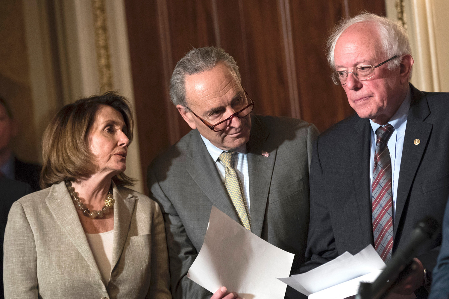 House Minority Leader Nancy Pelosi, Senate Minority Leader Chuck Schumer, and Sen. Bernie Sanders confer during a press conference on Capitol Hill, May 25, 2017 in Washington, DC.