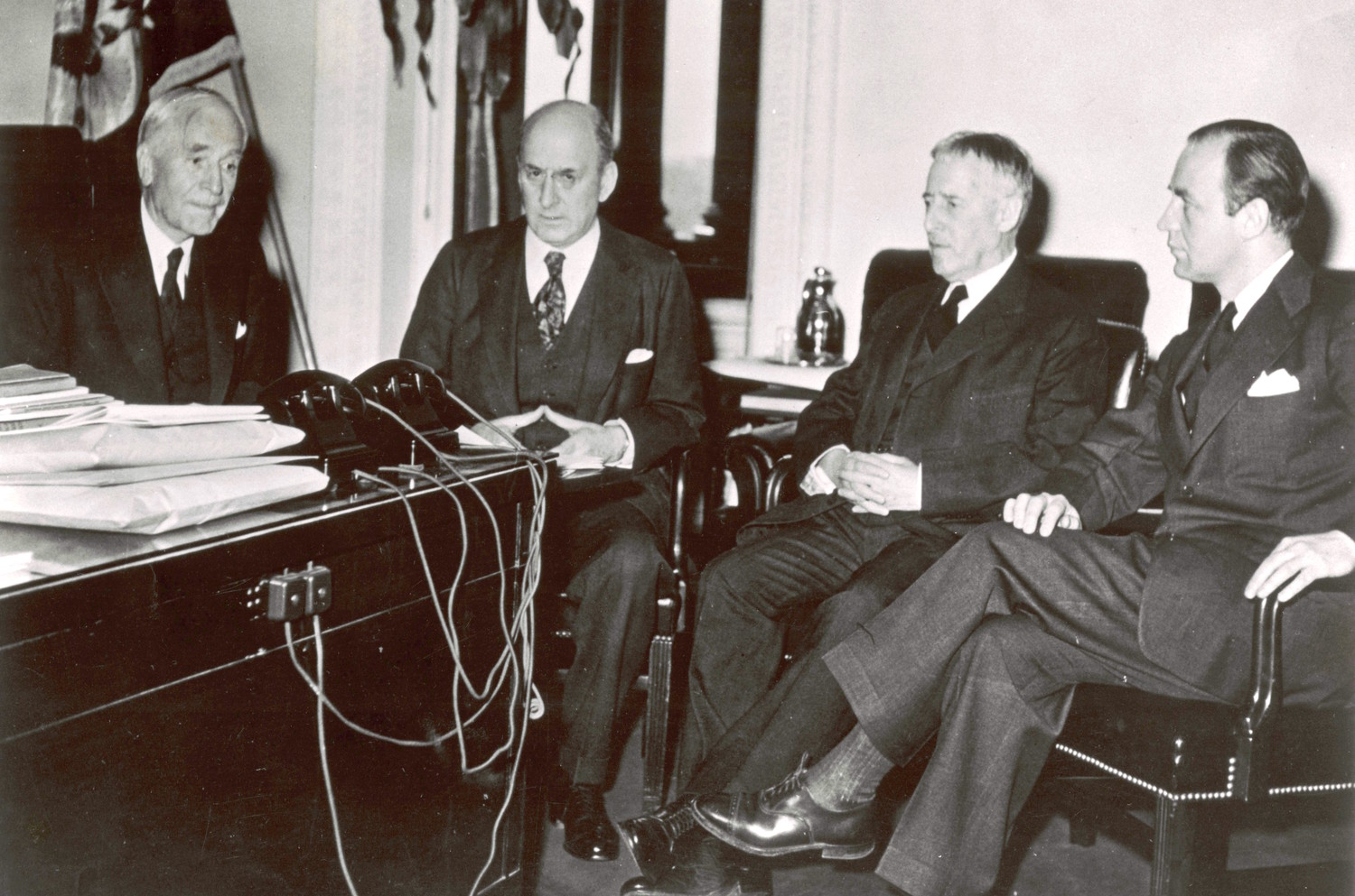 A meeting of the War Refugee Board in March 1944. From left: Secretary of State Cordell Hull, Henry Morgenthau, Henry Stimson, and John Pehle.