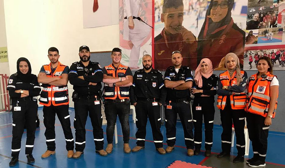 Muslim volunteers of United Hatzalah and the local ambulance team of Kfar Kara pose together after a training session. Sanaa Mahameed is third from the right.