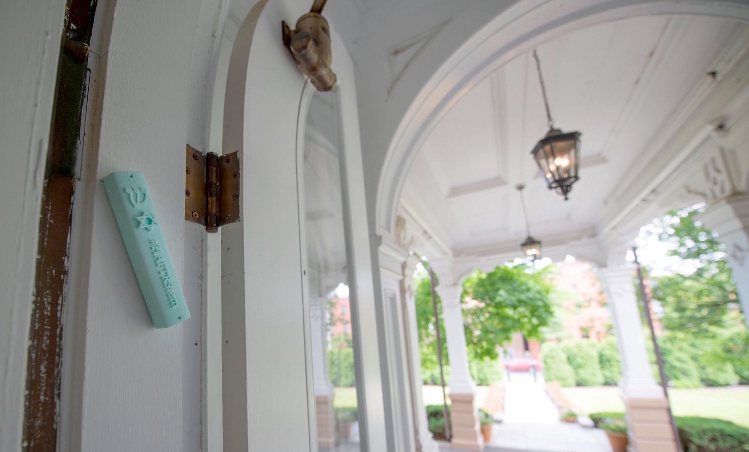 A mezuzah created by HAFTR students hangs outside the Governor's Mansion in Albany.
