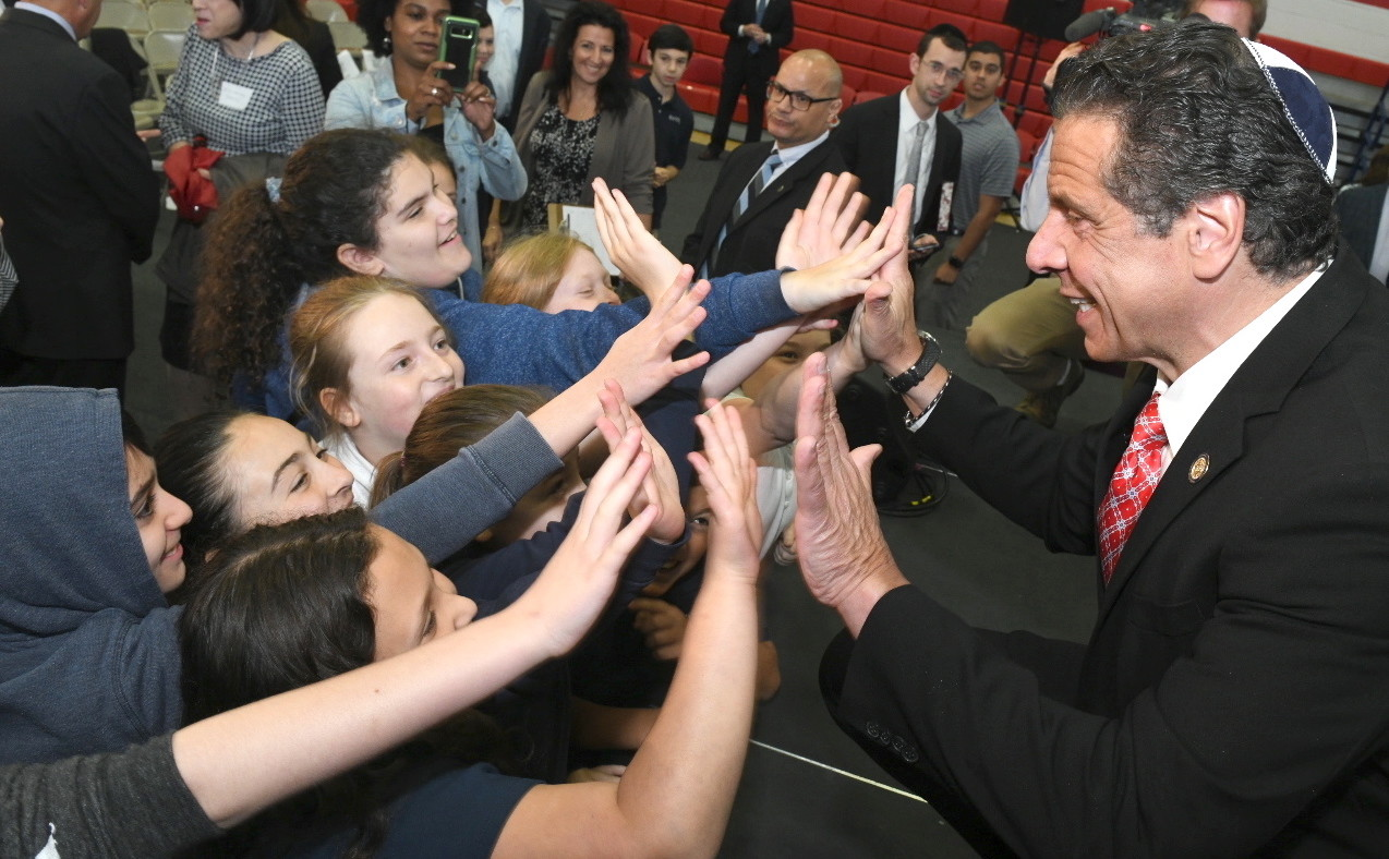 Gov. Cuomo high-fives HAFTR students during a visit last week.