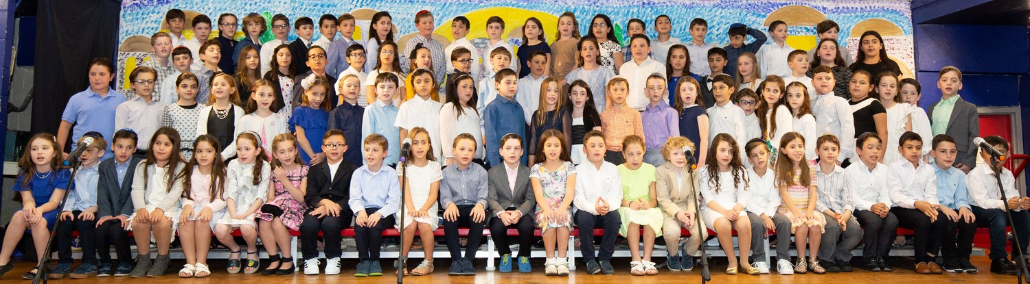 "HAFTR third graders posed for what their grandparents might have called a ""Kodak moment,"" during a M'Dor L'Dor: Generation to Generation evening."