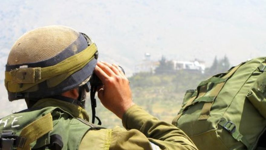 An Israeli soldier patrols near the Israel-Syria border in the Golan Heights.