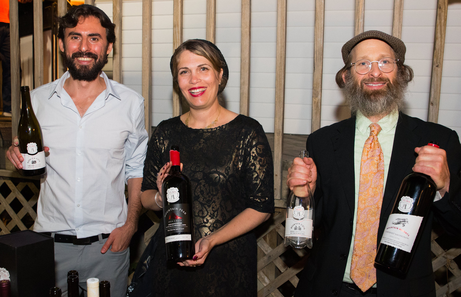 At One Israel Fund's West Hempstead BBQ, Vered Ben Sa'adon, winemaker and owner of the Tura Winery in the Shomron, is flanked by Yehoshua Werth and Tzvi Greg Lauren from Heart of Israel Wines.