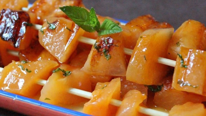 Grilled Strawberry, Cantaloupe and Honeydew Skewers with Midori and Lime Glaze.
