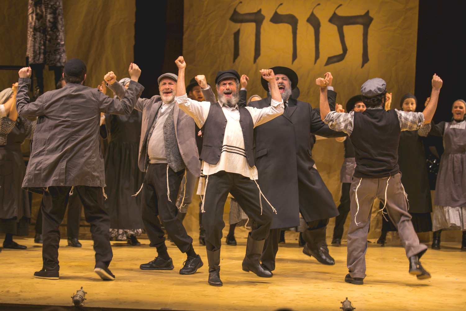 "Steven Skybell (center) is Tevye in a new National Yiddish Theatre Folksbiene's production of ""Fiddler on the Roof."""