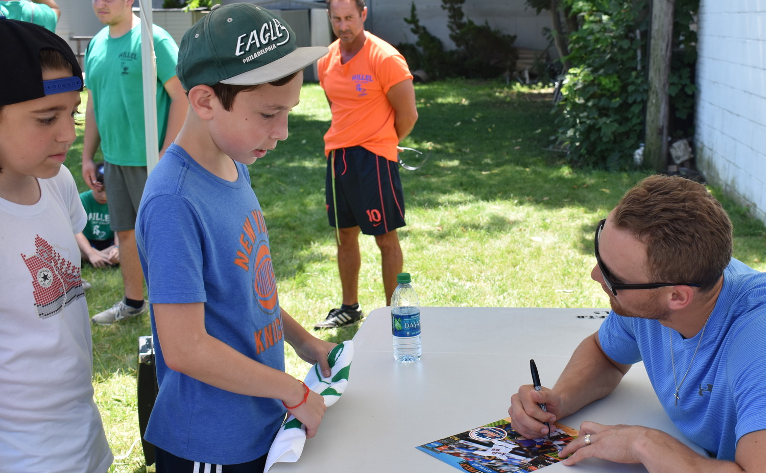Isaac Radzik, 11, may be wearing Eagles and Knicks gear, but he couldn't wait to get Nimmo's autograph at Hillel Day Camp in Lawrence.