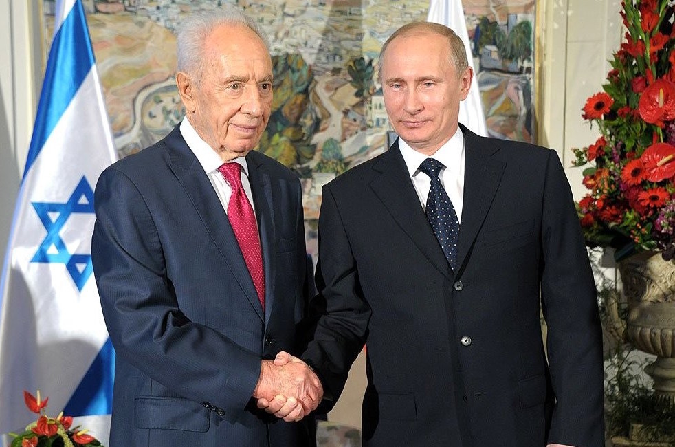 In Moscow, Russian President Vladimir Putin greets Israeli President Shimon Peres in 2012.