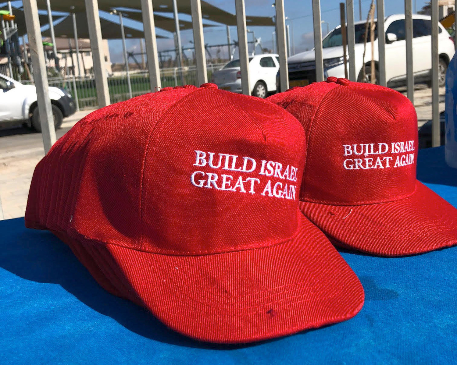 "Organizers of a brick-laying ceremony in Efrat distributed red caps bearing the slogan ""Build Israel Great Again,"" a gesture of thanks to President Donald Trump, on Aug. 1."