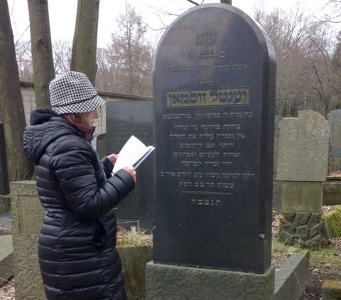 "Leba Sonneberg at the gravesite of her great-great-grandmother Yentel Sussman z""l, in Adass Yisroel Cemetery in Berlin."