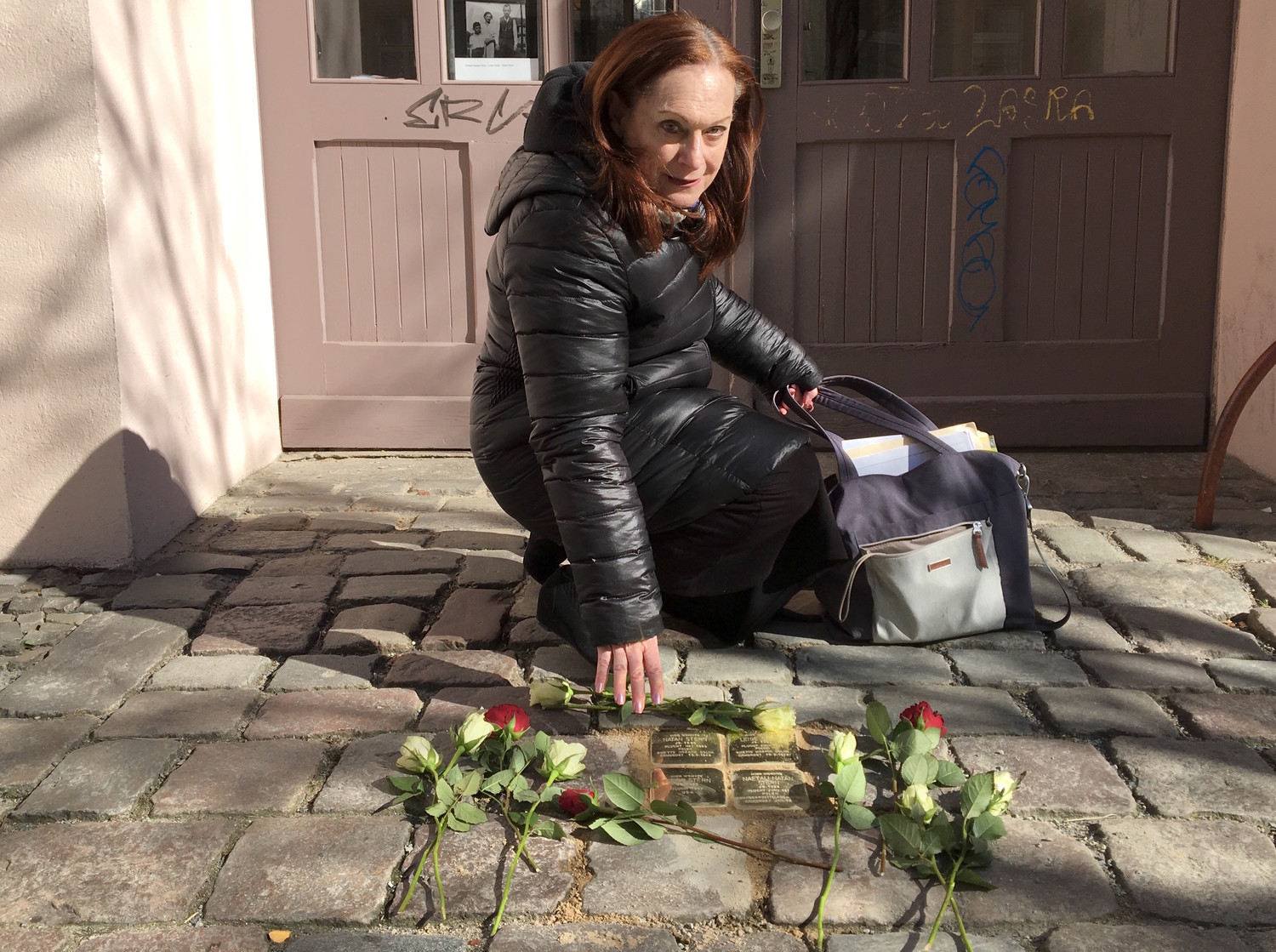Lena Sonneberg at the Stolpersteine outside the building where her grandparents lived.