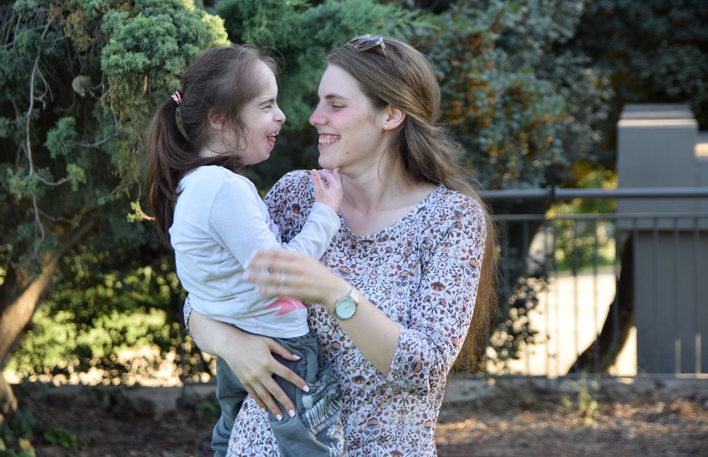 An ALEH volunteer spends time with a child with disabilities.