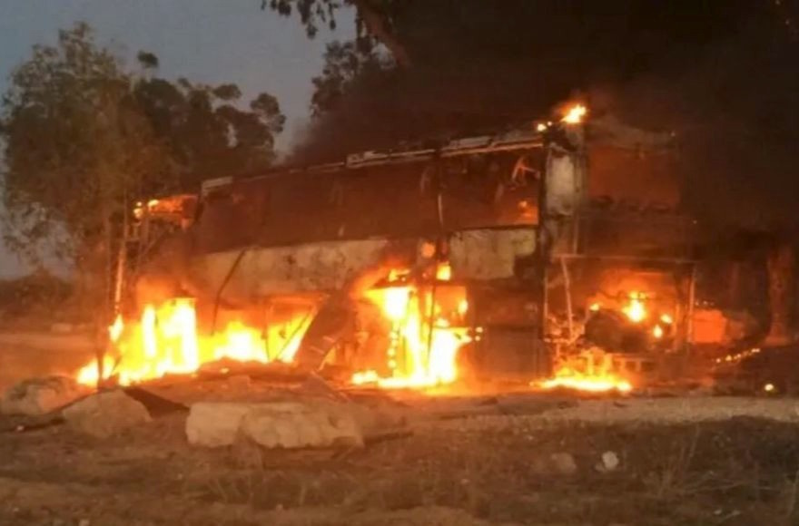 An Israeli bus traveling near the border with Gaza burns after being hit with Palestinian mortar fire on Monday. More than 450 rockets were fired into southern Israel from Gaza before a cease-fire took hold late on Tuesday.