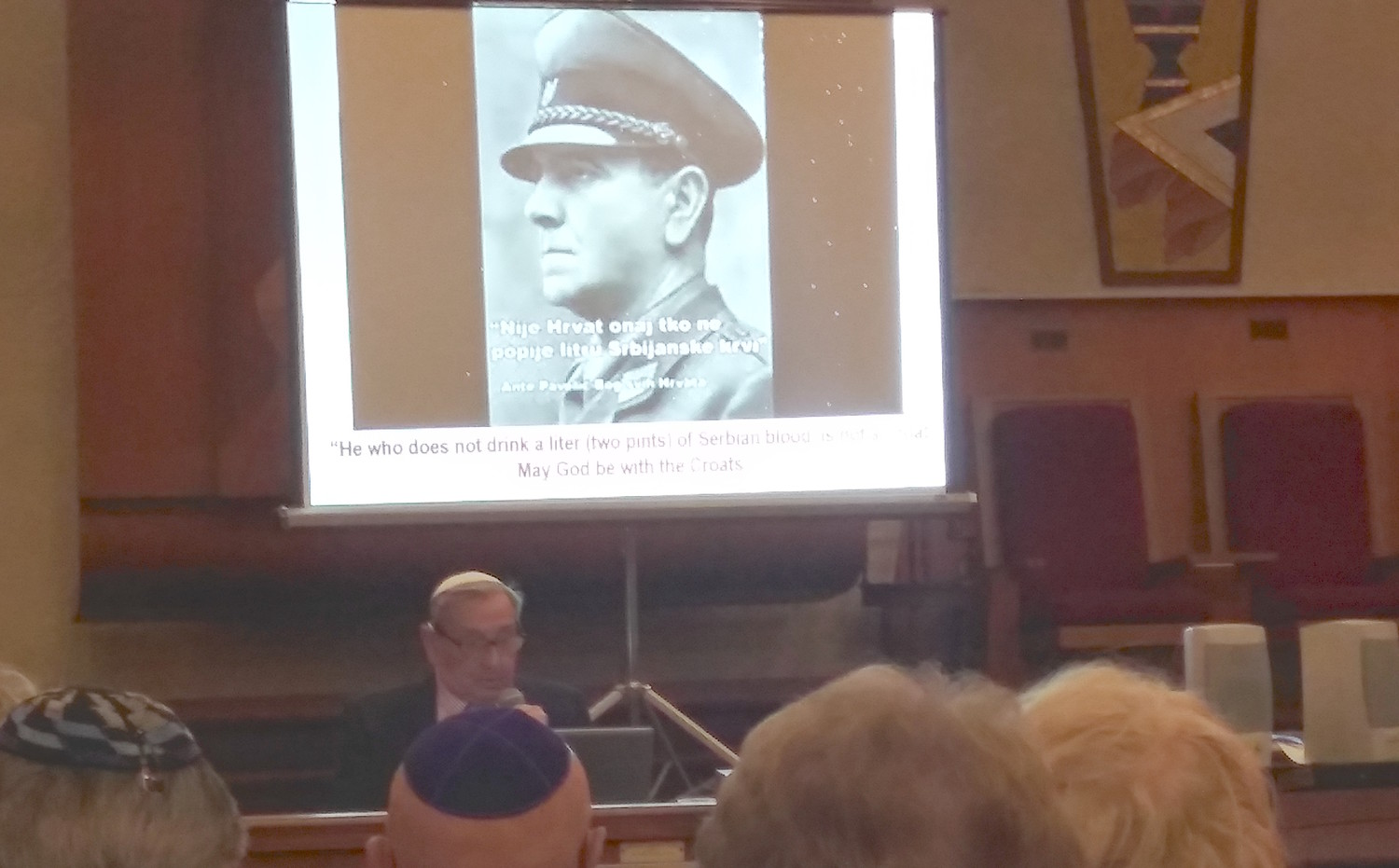 Werner Reich speaks at a Kristallnacht commemoration at the South Baldwin Jewish Center.