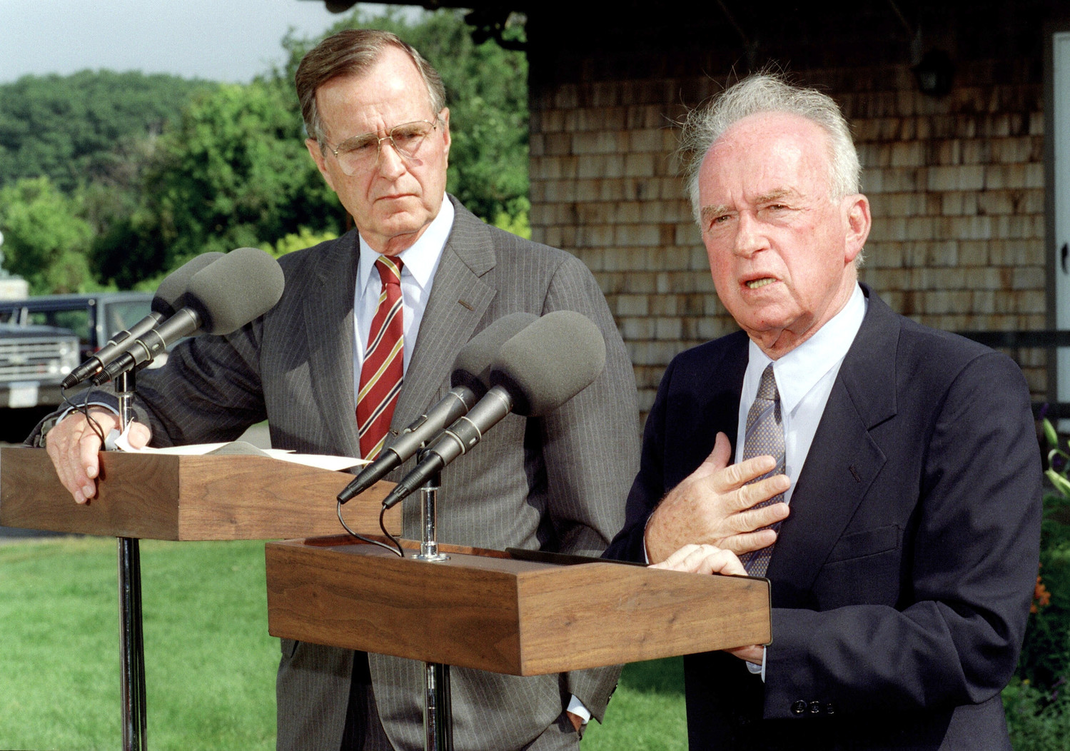 US President George Bush (L) listens to Israeli Prime Minister Yitzhak Rabin answer questions at a joint press conference, 11 August 1992, at Bush's Kennebunkport home. Bush announced a ten billion dollar loan guarantees for the Jewish state to help resettlement programs.