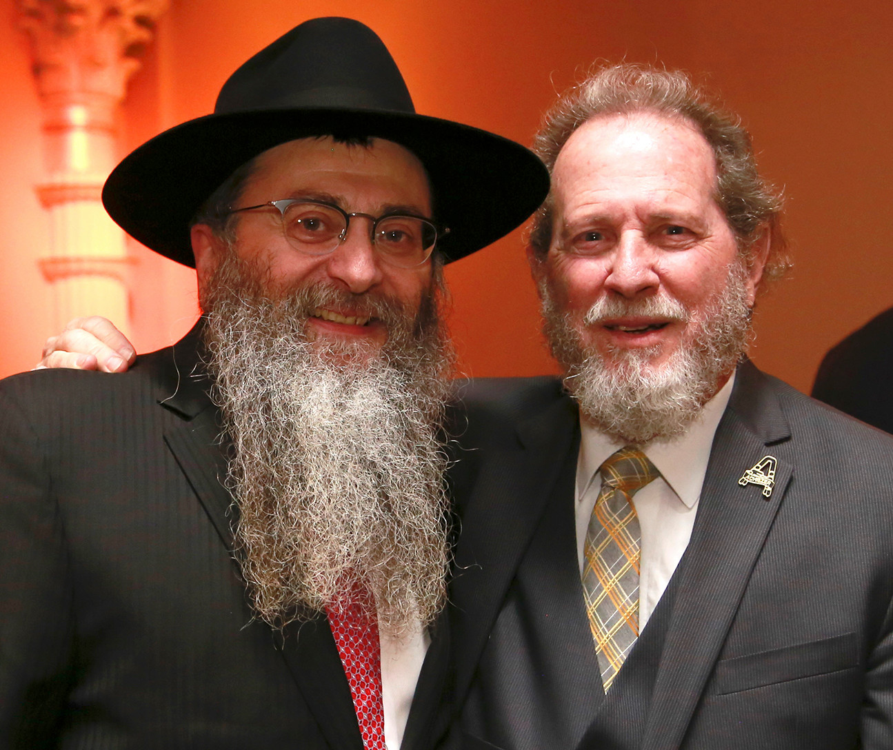 Rabbi Anchelle Perl of Chabad of Mineola and Achiezer board member Michael Krengel.