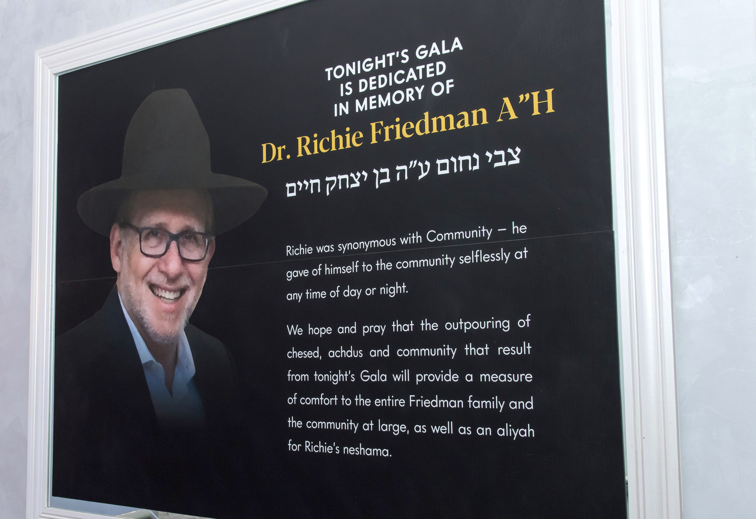 "A poster honors Dr. Richie Friedman a""h, the medical director of Chevera Hatzalah in whose memory the Jan. 6 Achiezer gala was dedicated."