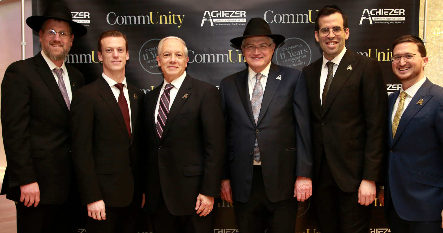 "Awardee lineup, from left: Rabbi Yossy Ungar, pillars of chesed; Dr. Ari Hoschander and Dr. Martin Keller, excellence in medicine; Ronald Lowenger, who participated in the dedication of the Edith Lowinger A""H Achiezer Volunteer Network; Rabbi Boruch Ber Bender with Shalom Jaroslawicz who, with his wife Leah, received the young leadership award."