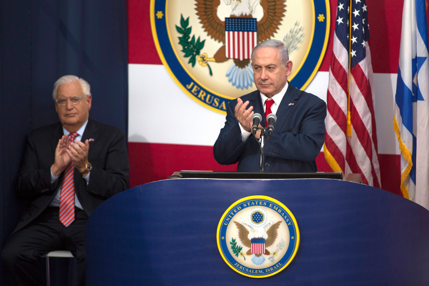 Israeli Prime Minister Benjamin Netanyahu, flanked by U.S. Ambassador David Friedman, speaks at the opening of the U.S. Embassy in Jerusalem, on May 14.