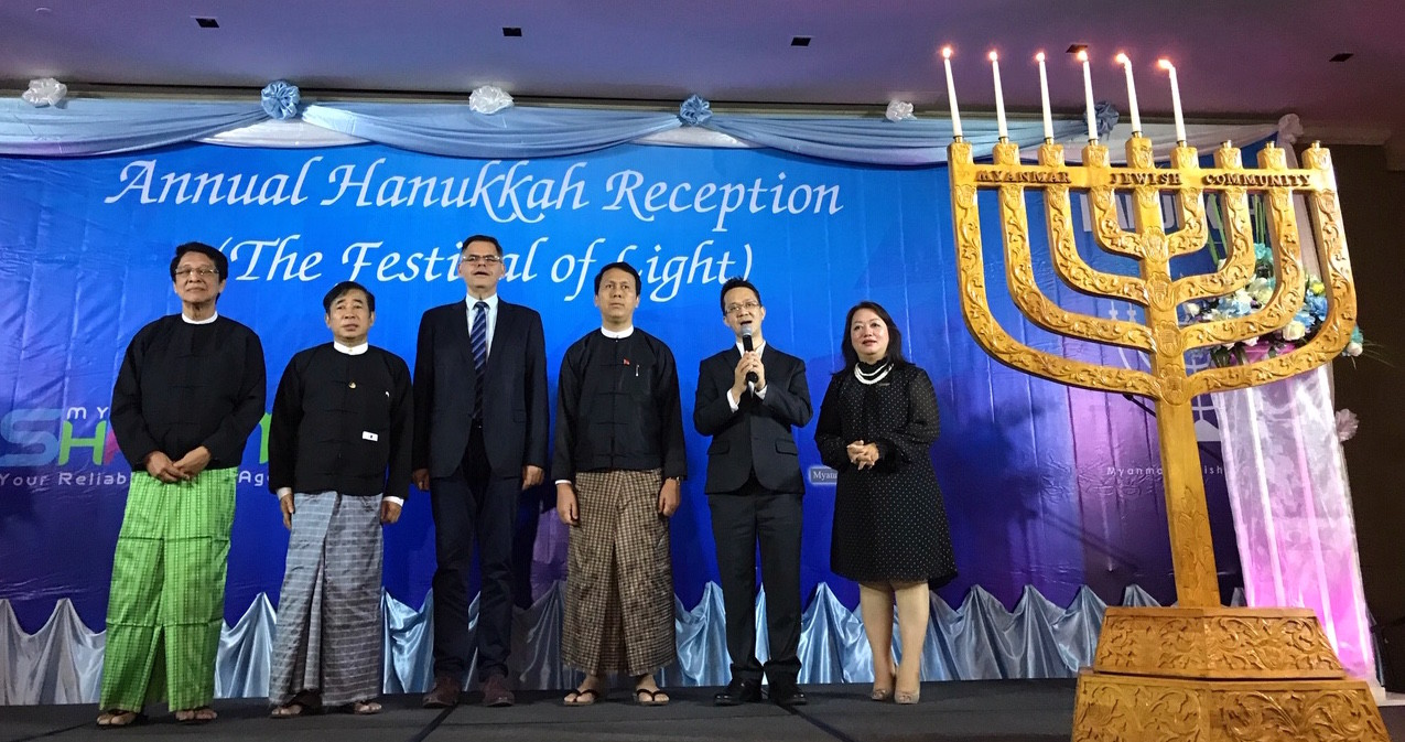 Sammy Samuels, second from right, sings at a Hanukkah event with Burmese leaders. Israel's ambassador to Myanmar, Ronen Gilor, is third from left; between them is Phyo Min Thein, the chief minister of the Yangon region.