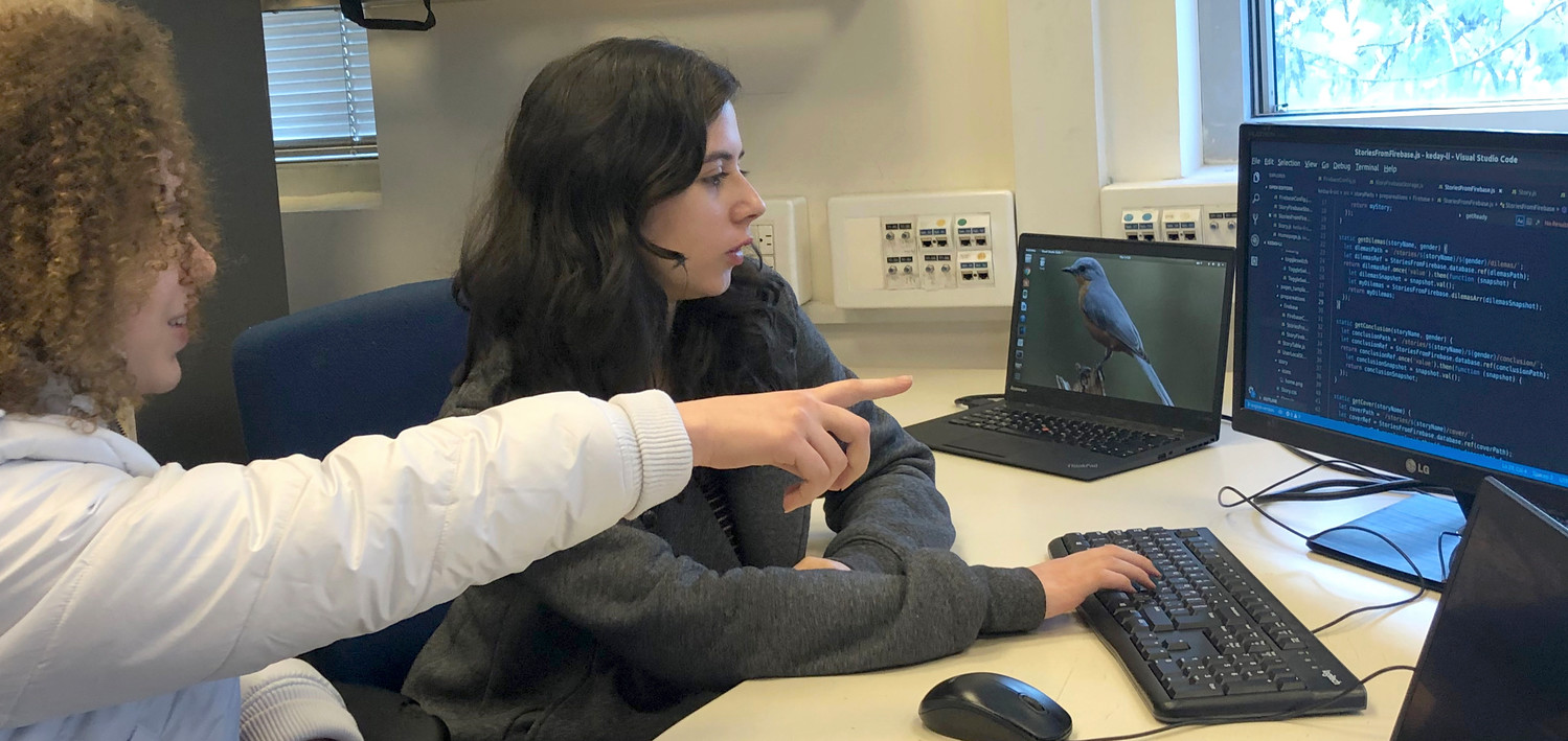 Ayelet Ganot, left, and Roni Ashkenazi, participants in the Carmel 6000 national service program, work on an app intended to help autistic children cope with change.
