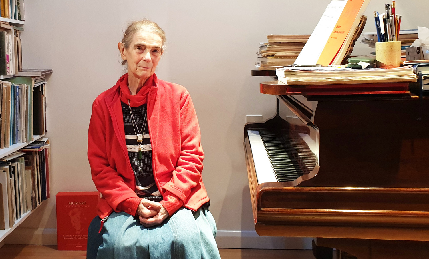 Nelly Ben-Or sitting by one of her two pianos in her London home on Dec. 13.