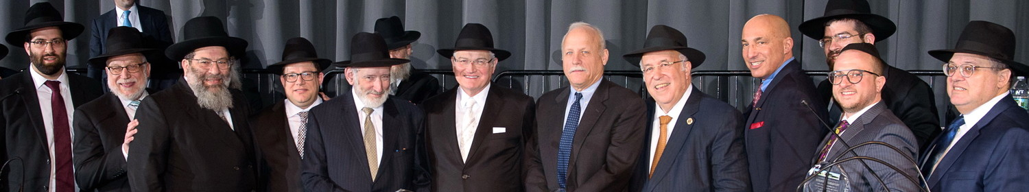 "At a gala for Far Rockaway's Yeshiva Darchei Torah, a presentation was made to individuals who were instrumental in securing the refinance of the Yeshiva's mortgage. From left: Rabbi Avrohom Bender, Rabbi Avraham Schachner, Rabbi Yaakov Bender, Shia Ostreicher, Samuel Krieger, Ronald Lowinger, Thomas Hunter of KeyBank, Rabbi Lloyd Keilson, John Manginelli of KeyBank, Rabbi Moshe Bender, Ben Orlofsky and Yossi Gross. The dinner drew over 2,000 guests to Darchei's Beach 17th Street campus to celebrate its ""Darchei Way"" — a compassionate, individualized approach to Jewish education."