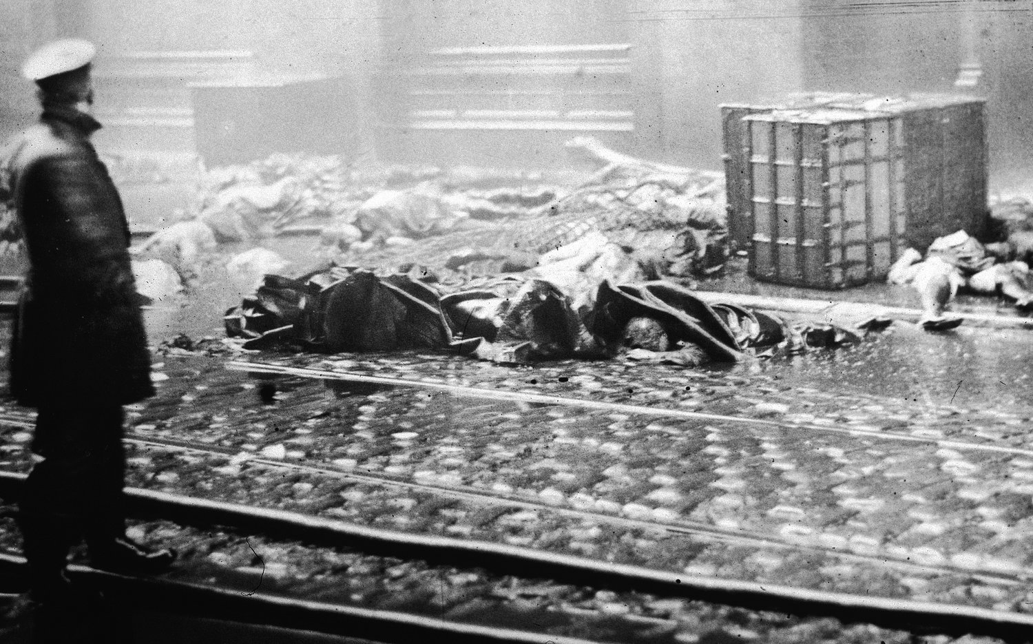 A policeman stands in the street, observing charred rubble and corpses of workers following the Triangle Shirtwaist Company fire in New York on March 25, 1911.