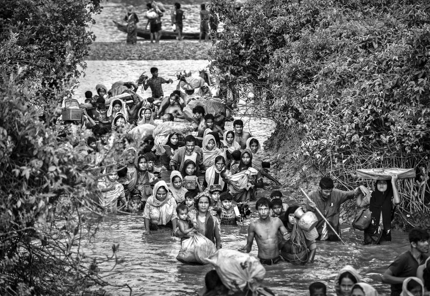 Rohingya Muslim refu-gees crowd a canal as they flee over the border from Myanmar into Bangladesh on Nov. 1, 2017]