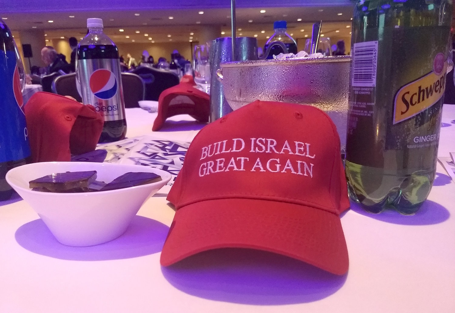 "Trump-style red ""Build Israel Great Again"" hats were distributed to gala attendees."
