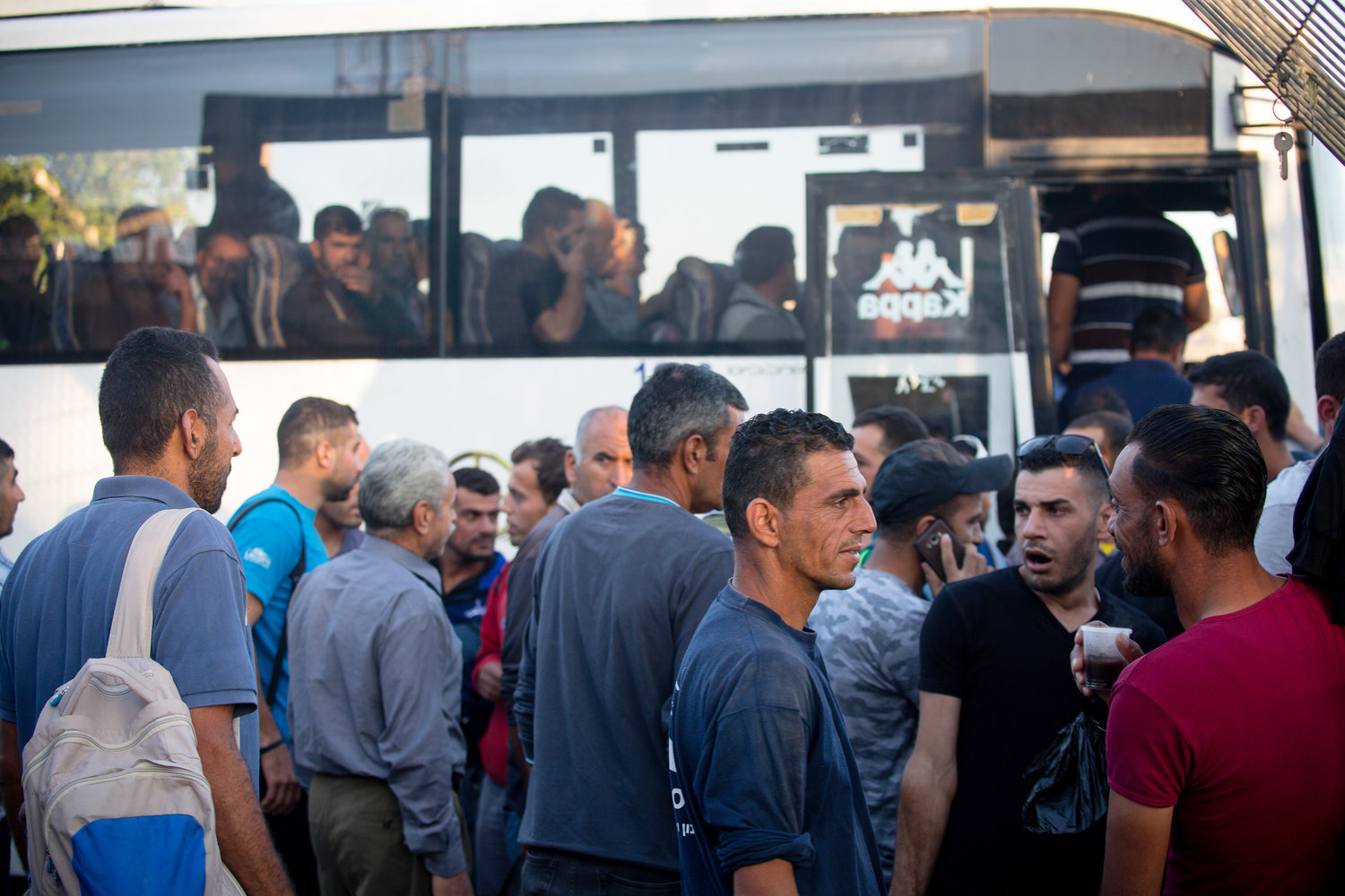 These commuters finally get to board their buses to their final destinations in Israel, after waiting at Checkpoint 300.