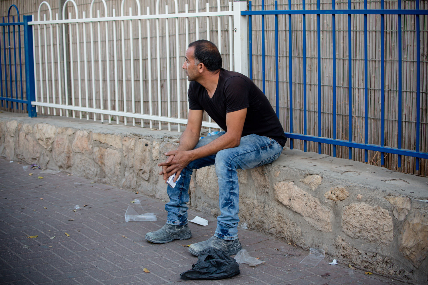 A Palestinian man waits at Checkpoint 300.