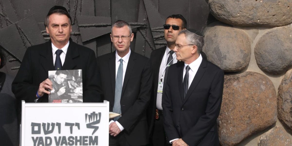 Brazilain President Jair Bolsonaro, left, with Israeli Tourism Minister Yariv Levin and Yad Vashem Director of External and Governmental Affairs Yossi Gevir at Yad Vashem Holocaust memorial in Jerusalem on April 2.
