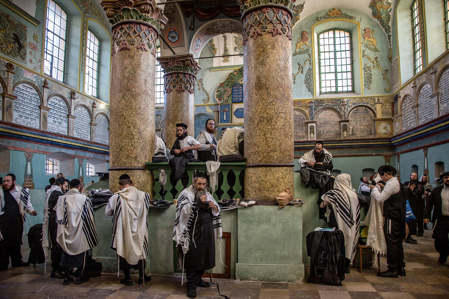 Hasidim gather for morning prayers at an old synagogue in Lancut.