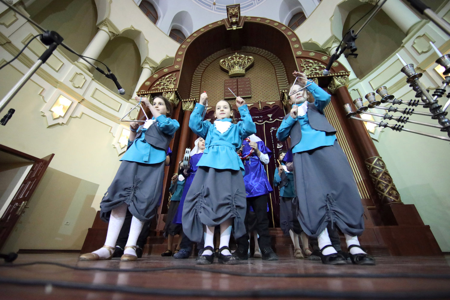 Children play musical instruments during the celebration of Chanukah at the Kharkiv Choral Synagogue, Kharkiv, northeastern Ukraine, on Dec. 5, 2018.