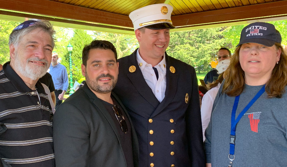 Dr. Paul Brody, who traveled from Great Neck to support the parade; Israeli musical superstar Gad Elbaz; Chief of Department John C. McHugh of the volunteer Lawrence-Cedarhurst Fire Department; and Lawrence Association President and parade organizer Penina Popack.